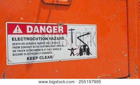 Danger Sticker Sign And Symbol On Electrocution Hazard Machine, Macro Photo Focus Select At Exclamat