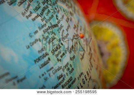 Macroshot Of Holiday Location Pinned On A Globe