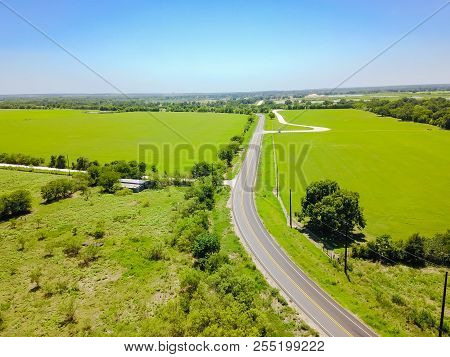 Top View Country Road And Grassy Farmland In Hill Country, Texas, Usa