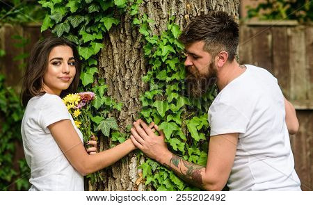 Man Bearded Hipster Holds Hand Girlfriend. Couple In Love Romantic Date Walk Nature Tree Background.