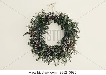 Modern Christmas Wreath. Stylish Rustic Christmas Wreath With Pine Cones,fir Branches,snow, Hanging