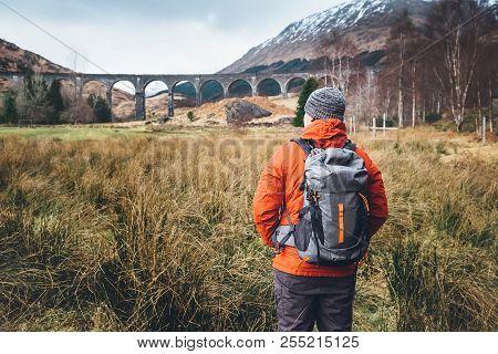 Hiking, Walk With Backpack, Active Lifestyle Concept Image. Man Traveler Walks Neaar Famous Glenfinn