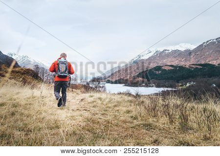 Hiking, Walk With Backpack, Active Lifestyle Concept Image. Traveler With Backpack Walks Among The H
