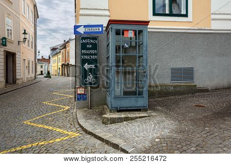 Ybbs An Der Donau, Austria - July 8, 2018. Telephone Booth On A Paved Street In The Historical Cente
