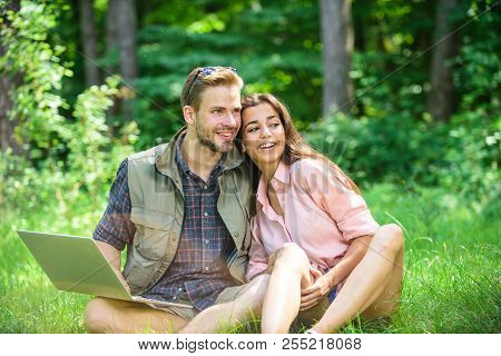 Couple Youth Spend Leisure Outdoors With Laptop. Man And Girl Working With Laptop At Green Meadow. M