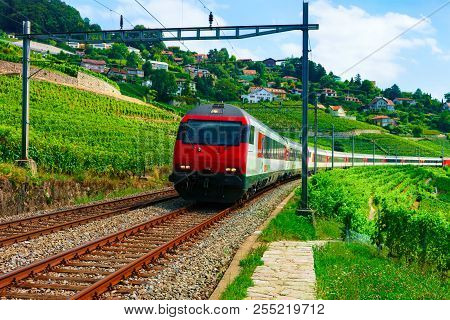 Lavaux, Switzerland - August 30, 2016: Running Train And The Railroad At Lavaux Vineyard Terraces Hi