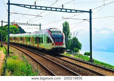 Lavaux, Switzerland - August 30, 2016: Train Near Vineyard Terrace Of Lavaux At Lake Geneva And Swis