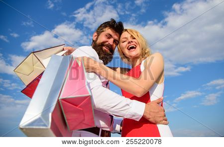 Shopping Brings Positive Emotions. Couple With Shopping Bags Hugs Blue Sky Background. Man Beard And