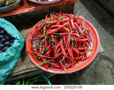 A Bowl Of Bright Red Chilli In A Market In Phonsavan - Eastern Laos. Markets Selling Fresh Produce A