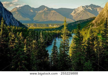 Majestic Mountain Peaks Over Bow River In Banff, Alberta, Canada