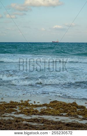 Breezy Sunset With Colorful Ocean Waves And Ship At Fort Lauderdale Beach In Florida