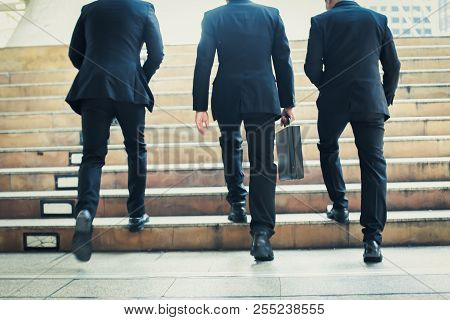Group Of Business People Standing Talking About Work With A Work Plan.business Team Standing Holding
