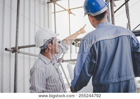 Construction Engineers Talk To Architects At Construction Sites Or Buildings.they Makeing Are Constr