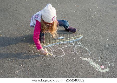 Drawings On The Sidewalk, Girl Child Draws A Unicorn.