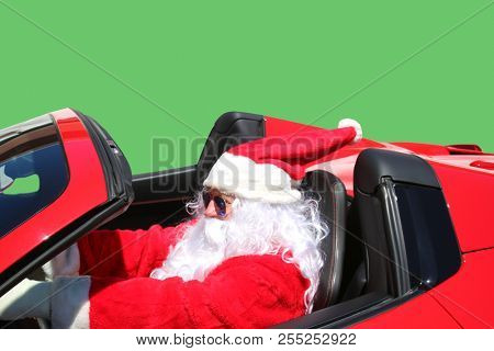 Santa Claus Green Screen. Santa Claus drives his red hot rod with a Green Screen or Chroma Key Green background. Clipping path. Green easily replaced with your background choice.