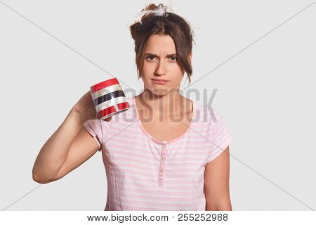 Discontent Upset Woman In Pyjamas Keeps Mug Down, Demonstrates That She Has No Coffee To Drink, Need