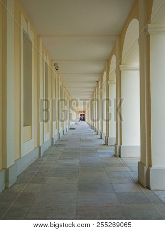 Linear Perspective In Architecture. Beige A Long Corridor