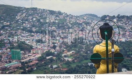 Buddha Statue Looking At The Mountain Town In Taunggyi, Myanmar