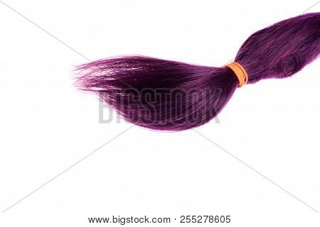 Isolated Purple Weft Of Hair With Ponytail Holder