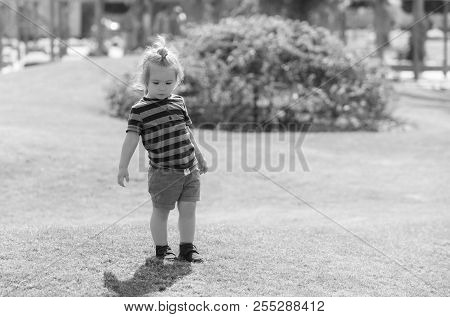 Summer Vacation, Traveling. Cute Baby Boy, Small, Little Child With Blond Hair In Blue Striped Cloth
