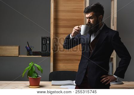 Businessman Drinking Coffee In Office. Time To Relax. Bearded Businessman Hold Cup Of Coffee/tea. Bu