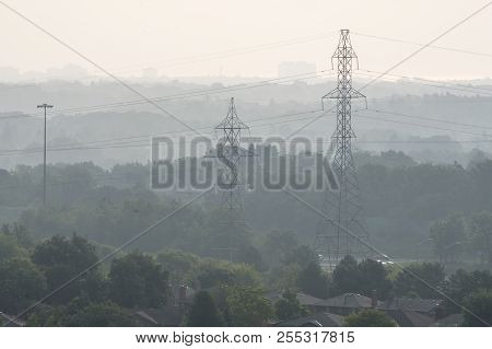Power Lines And Trees Seen Through Haze In City Of Mississauga Near Toronto Early In The Morning