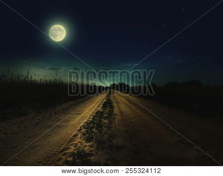 Beautiful Magic Night Sky With Fullmoon And Stars And  Road Receding Into The Distance With  Green G
