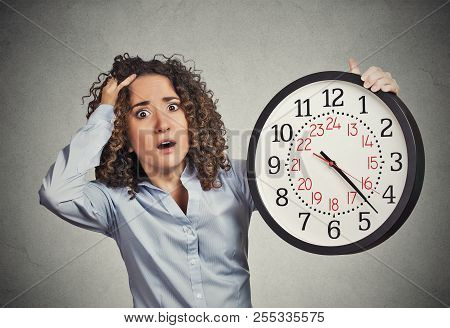 Time Pressure. Closeup Portrait Woman Stressed Corporate Employee Holding Clock Looking Anxiously Ru