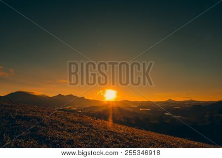 Silhouettes View Beautiful Sunrise On Highland With Mountain, Nature Background. Royalty High-qualit