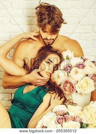 Sexy Couple Young Beautiful Cute Lovers In Love Pretty Girl And Sexi Man With Boxes Of Flowers Hug O