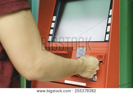 Close Up Young Man Hand Using Atm Card Or Credit Card With Bank Machine For Withdraw Money. Hand Wit