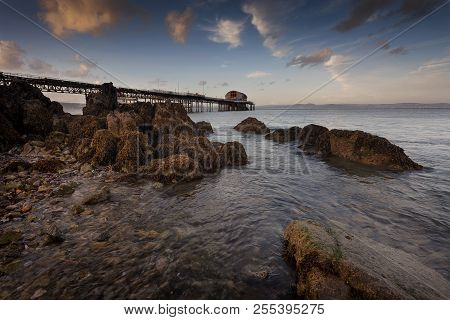 Rocky Foreshore At Mumbles Pier A Calm Evening At Mumbles Pier, Showing The New Lifeboat Station, Sw