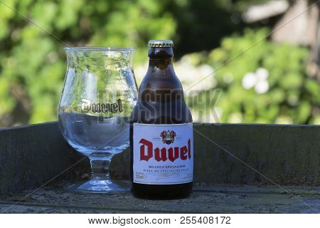 Sint Gillis Waas, Belgium - June 20, 2018: Belgian Beer Duvel With Cold Glass On A Warm Spring Eveni