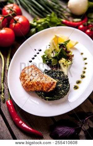 Baked Salmon Steak With Spinach And Lemon Slice A