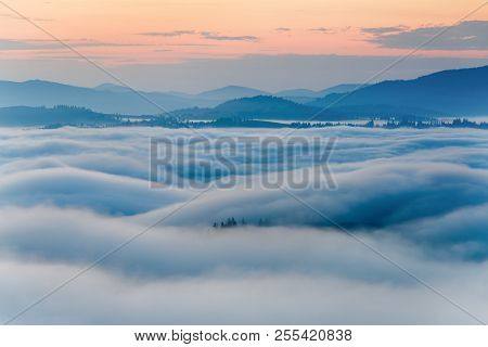 Fog In Mountains. White Wavy Fog At The Sunrise. Vivid Tranquil Landscape.