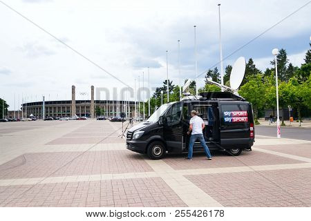 Berlin, Germany - May 15 2018: Sky Sports Television Production Truck Stands In Front Of Olympic Sta
