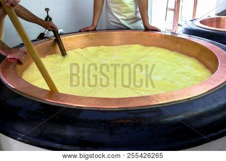 Team Of Cheesemakers At Work In A Dairy