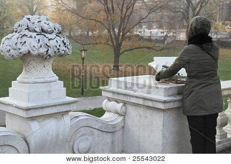 The girl drawing a park landscape.Vienna
