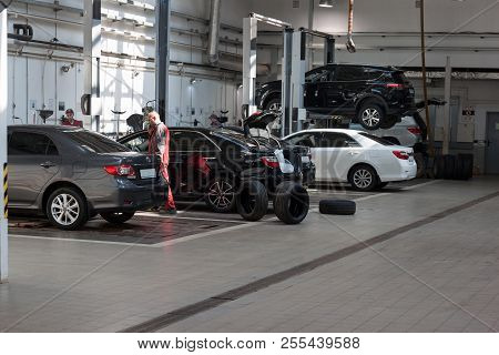 Russia, Izhevsk - April 21, 2018: Automobile Workshop. Scheduled Replacement Of Wheels And Car Repai
