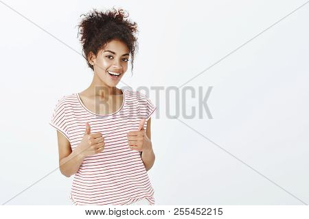 Totally Agree With Your Opinion. Satisfied Happy And Outgoing Woman With Dark Skin In Striped T-shir