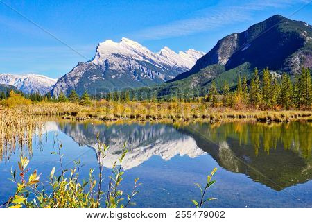 Reflection Of Rocky Mountains In Vermillion Lakes