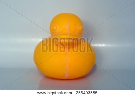 Front View Of A Yellow Plastic Rubber Ducky, Ducky, Floating Bath Time Toy For Children On A White B