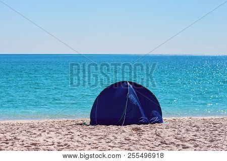 A Small Blue Round Collapsible Shade Tent On The White Silica Sand Of Whitehaven Beach In The Whitsu