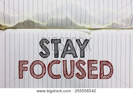 Handwriting text Stay Focused. Concept meaning Be attentive Concentrate Prioritize the task Avoid distractions Open notebook page crumpled papers ripped pages several tries mistakes. poster