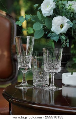 Crystal Glasses On A Dark Wooden Table