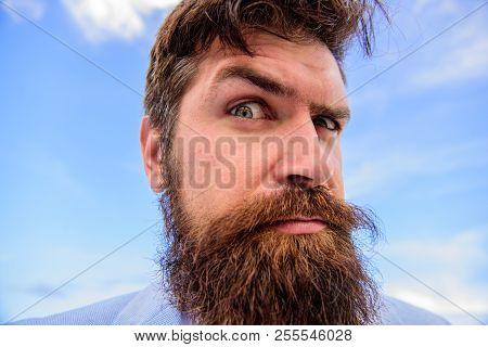 Expert tips for growing and maintaining moustache. Man bearded hipster with mustache sky background. Ultimate beard and moustache grooming guide. Hipster handsome bearded attractive guy close up. poster
