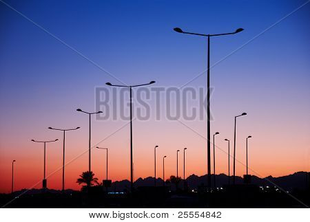 Pillar Street Spotlights In Front Of Sunset Sky