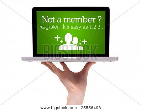 Hand holding laptop with register sign