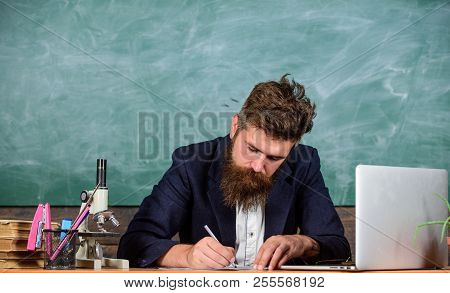 Writing Report. Teacher Bearded Man Writing With Pen Busy With Paperwork. Teachers Daily Routine Pap