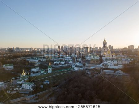 Panoramic view to historical famous places the Pechersk Lavra - most ancient monument of UNESCO, in Kiev, Ukraine at sunset in the summer. Panoramic photography from the drone.
